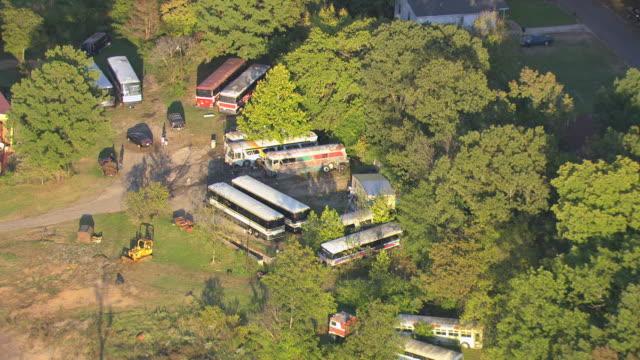WS AERIAL View of bus graveyard / Birmingham, Alabama, United States