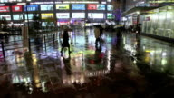 WS View of Busy pedestrian street reflections on rainy night in Akihabara / Tokyo, Japan