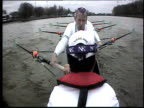 View of Cambridge boat crew rowing from boatcam above Cox's head 2003 University boat race London