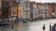 WS View of Canal Grande near Ponte di Rialto and journey of gondolas at sunset / Venice, Veneto, Italy