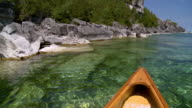 WS POV View of canoe bow moving at Georgian bay shoreline / Tobermory, Ontario, Canada
