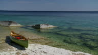 WS View of canoe on rocks at Georgian bay with seascape in background / Tobermory, Ontario, Canada