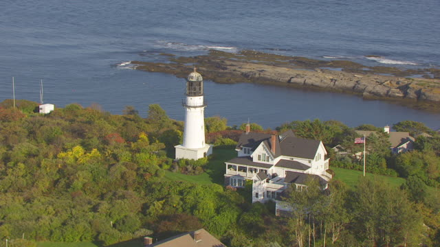 WS AERIAL POV View of Cape Elizabeth Lighthouse with sea/ Cape Elizabeth, York County, Maine, United States