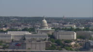WS AERIAL View of Capitol Building and city Skyline / Washington, Dist. of Columbia, United States