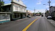 WS POV T/L View of car driving through Honokaa Town with stores on roadside / Honokaa, Hawaii, USA