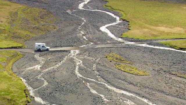 WS TS ZI ZO AERIAL View of Car moving on dirt road / Iceland