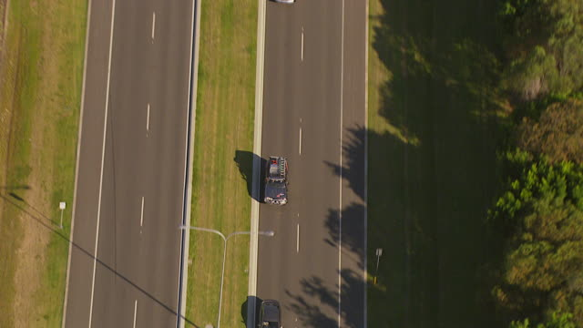 WS AERIAL ZI ZO TS View of car on road / Brisbane, Victoria, Australia