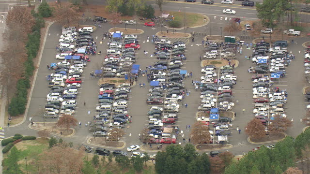 WS AERIAL View of Car parking area with people on Wallace Wade Stadium / North Carolina, United States