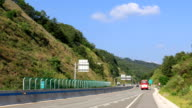 View of car passing on the Chuncheon expressway (An alternative link from Seoul to the East Coast area of Korea)