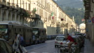 WS View of Car, trolley traffic and people in via Po with hills in back side / Turin, Piedmont, Italy