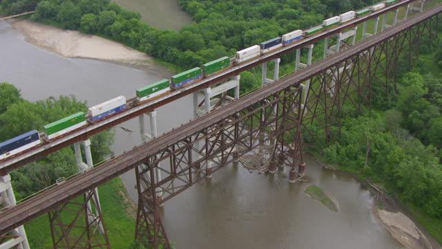 WS AERIAL POV View of cargo train crossing Kate Shelley High Bridge / Boone, Iowa, United States