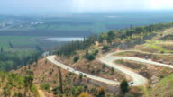 WS PAN View of cars moving in valley / Jezreel Valley,  Isarel