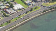 MS AERIAL ZI TS TU View of cars moving on road and bridge near ocean at Pyramid Rock / Phillip Island, Victoria, Australia
