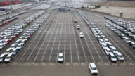 View of cars parking in a row and some cars running at export pier of Sinhangman