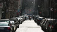 WS View of cars running on shining Broadway and pedestrians walking down sidewalk / New York, United States