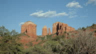 WS View of cathedral rock with moon behind clouds / Sedona, Arizona, USA