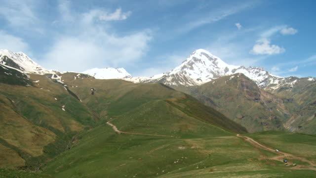 WS PAN View of Caucasus mountains valley and snowy peak / Stepantsminda, Kazbegi, Georgia