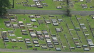 WS AERIAL ZO View of cemetery in town at coast / Newcastle, New South Wales, Australia