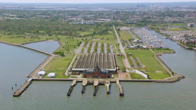 WS AERIAL DS ZI View of Central railroad terminal at Liberty State Park to railroad tracks / Jersey City, New Jersey, United States