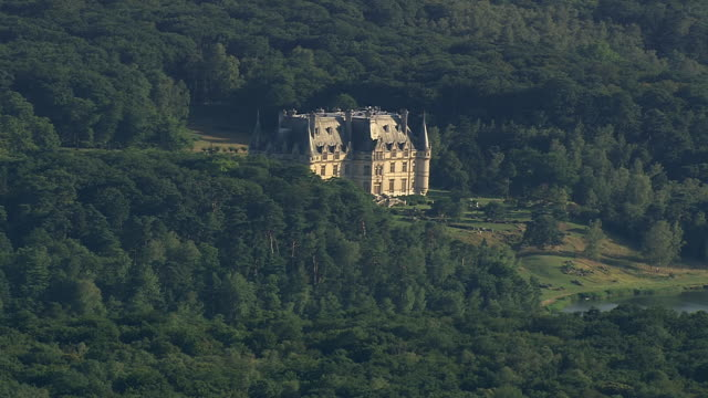 MS AERIAL TS View of Chateau surrounded by tree / Picardy, France