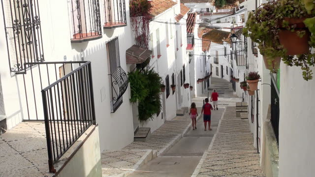 MS View of Children walking between houses at mountain village Mijas / Mijas, Andalusia, Spain