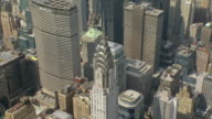 WS AERIAL View of Chrysler Building in Turtle Bay neighborhood in Manhattan with other building / New York, United States