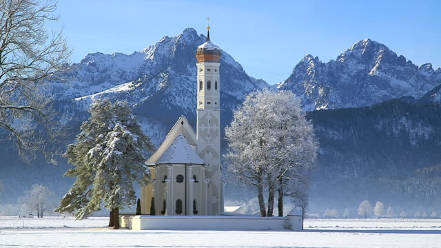 WS View of church St. Coloman near Schwangau in winter / Schwangau, Bavaria, Germany