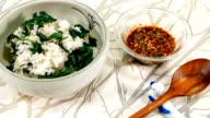 View of Chwinamul (aster scaber) bibimbap (mixed rice) with sauce (Popular Korean dish)