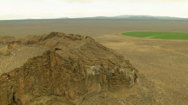 WS AERIAL View of circle walls and ridge of Fort Rock volcanic rock formation / Oregon, United States