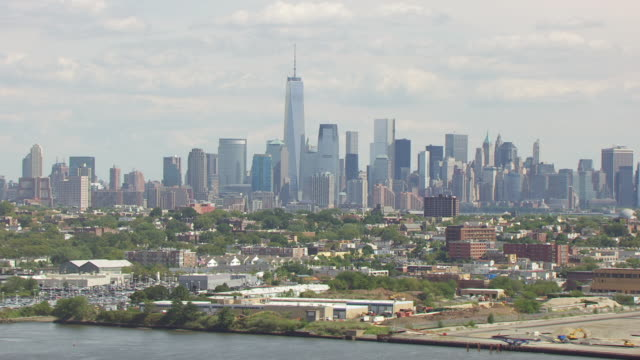 WS AERIAL View of city and Manhattan in in distance / New Jersey, United States