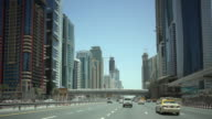 WS POV View of city and traffic through Sheikh Zayed Road / Dubai, United Arab Emirates