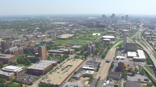 WS AERIAL View of city with Gateway Arch and downtown in back side / St Louis, Missouri, United States