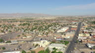 WS AERIAL View of City with highway and Ysleta Mission / El Paso, Texas, United States