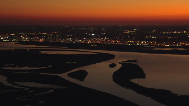 WS AERIAL View of city with night lights from Mobile River / Mobile, Alabama, United States