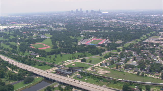 WS AERIAL View of City with stadium and city highway / Louisiana, United States