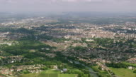 WS AERIAL View of city with wooded area (Viellesegure) / Aquitaine, France