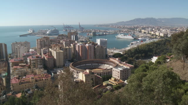 WS View of cityscape near by ferry at harbour / Malaga, Andalusia, Spain