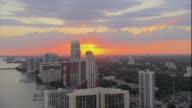 WS PAN ZI POV View of cityscape skyscrapers at sunset / Miami, Florida, USA