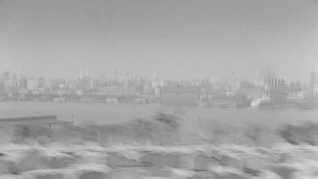 WS POV View of cityscape with driving along Hudson River looking at New York skyline