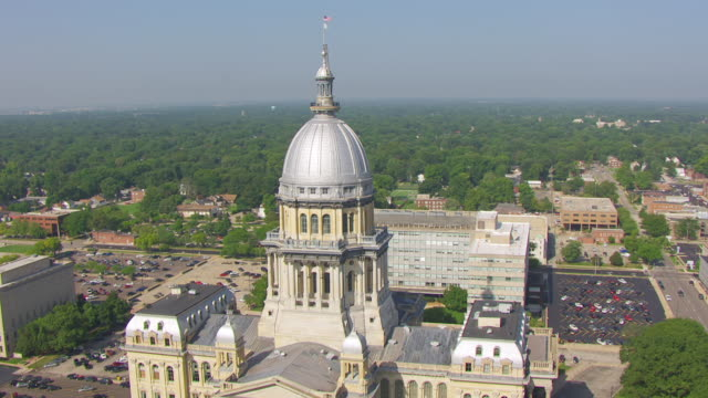 WS AERIAL POV View of cityscape with Illinois State Capitol building / Springfield, Illinois, United States