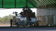 MS View of Cleaning Helicopter After Flight / Truscott, Western Australia, Australia