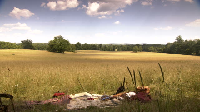 WS View of Cloud shadows over empty battlefield and remnants of abandoned picnic site / Middleburg, Virginia, United States
