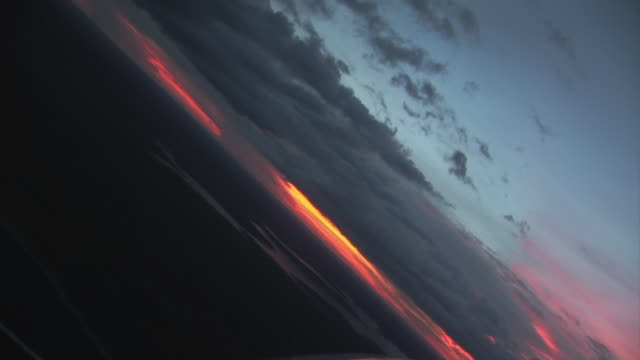 AERIAL POV TITLED view of clouds and sunset / Darwin, Australia