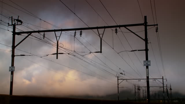 WS T/L View of clouds moving over cables / South Africa