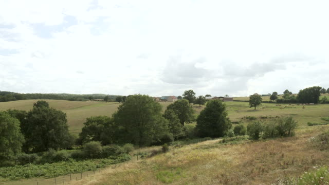 WS T/L View of clouds moving over farmland / Beaune, Burgundy, France