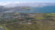 WS AERIAL View of clouds over Reykjavik city with bay / Iceland
