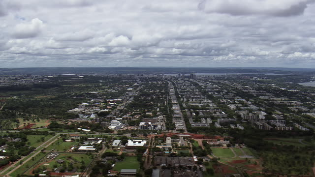 WS AERIAL View of clouds over town / Brasilia, Brazil