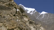 WS T/L View of clouds passing over dark mountain peaksat evening / High Himalayas,UpperDolpo, Nepal