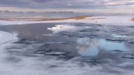 WS AERIAL View of clouds reflections in ice lake / Iceland