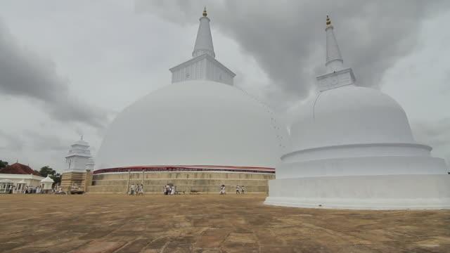 MS View of Clouds rush over Ruwanwelisaya Dagoba or Stupa one of world's tallest monuments / Anuradhapura, North Central Province, Sri Lanka